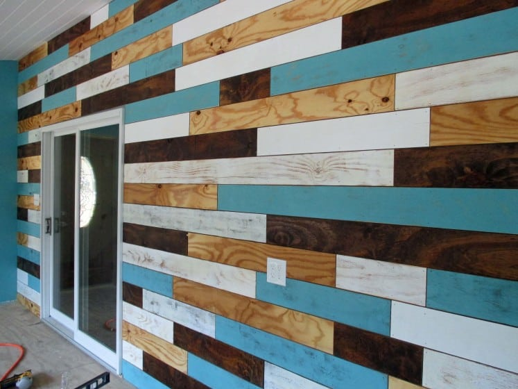feature wall using wood planks in various colors of paint and stain
