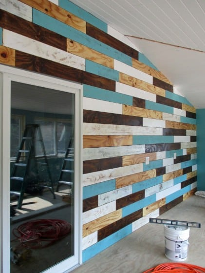 long wall featuring planks of wood in various colors