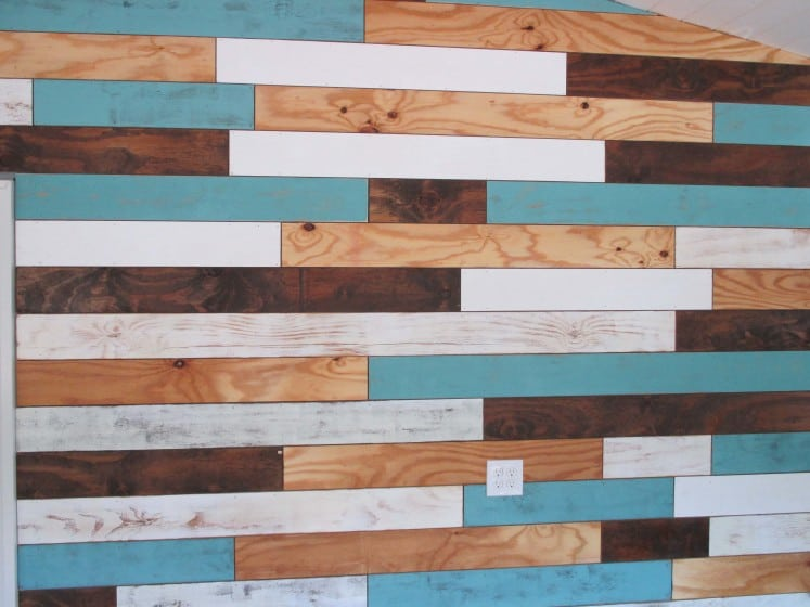 plank wall with natural, aqua, walnut, and white pieces
