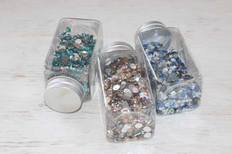 sequins organized in clear jars with lids