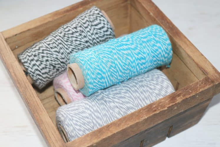 wooden basket filled with twine