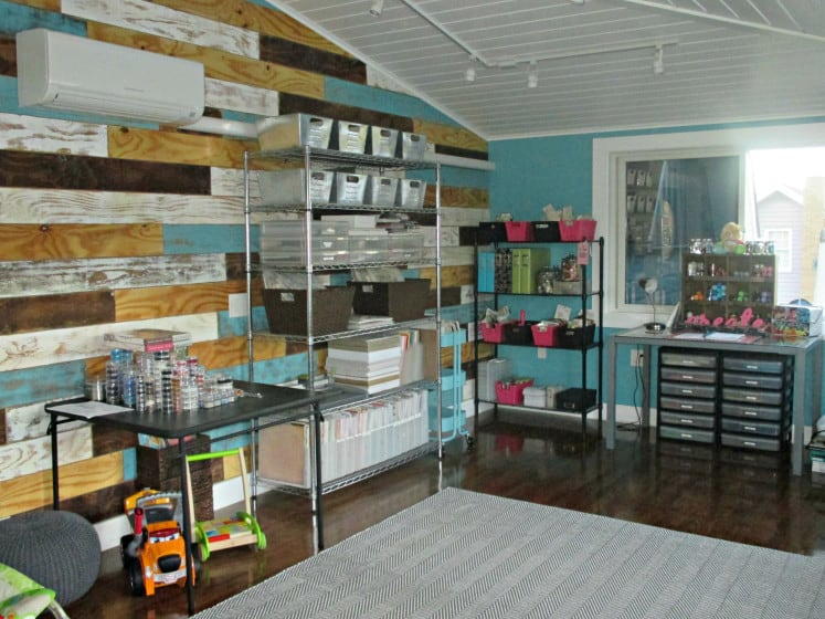 desk and several different shelves filled with organized craft supplies