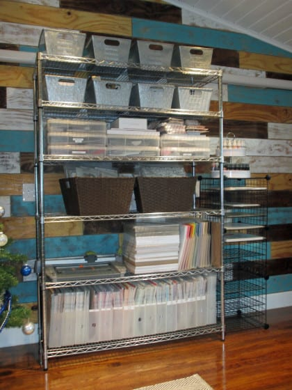 wire shelf filled with baskets and bins of scrapbooking supplies