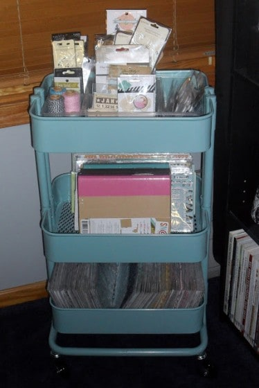 rolling cart filled with scrapbooking supplies