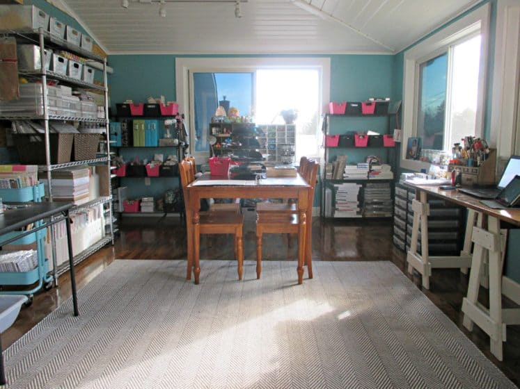 organized craft room with several shelves and workspaces