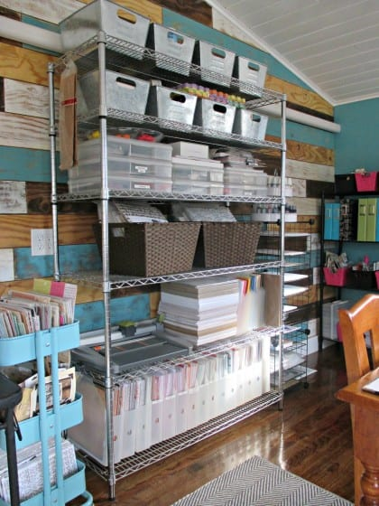 large wire shelf filled with scrapbooking supplies organized into different types of containers