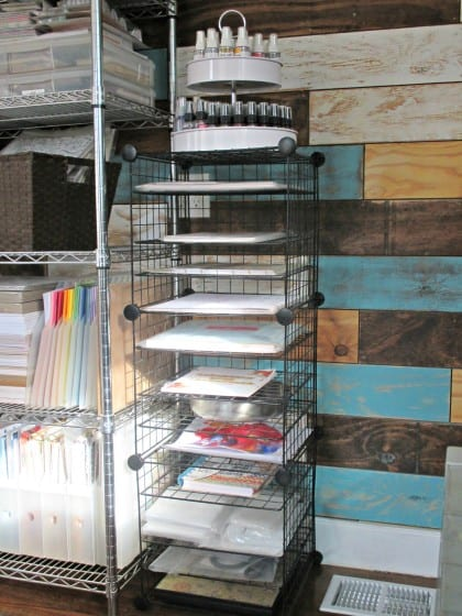 wire shelf filled with unfinished projects and kits