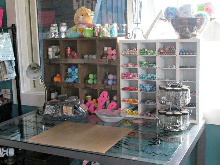 desk with organized mixed media and art journaling supplies
