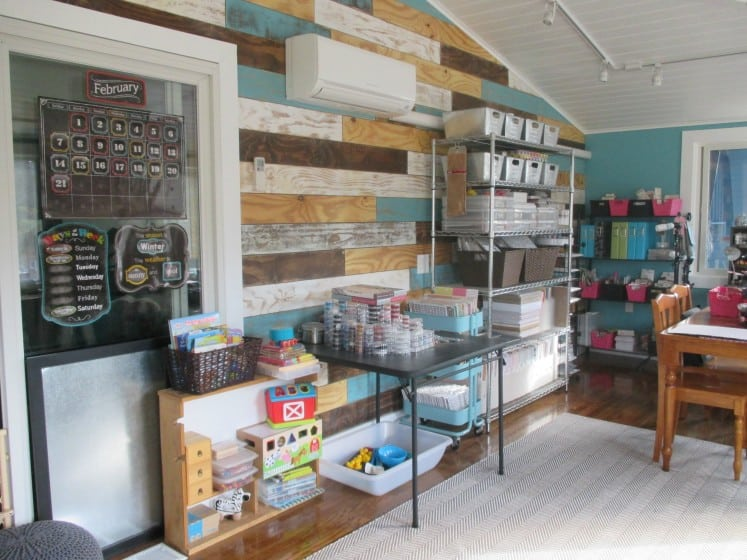 child's play area within a craft room next to a table containing beads organized into clear stacking containers