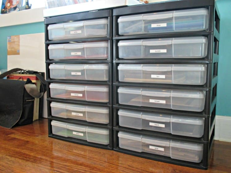 Iris storage units filled with paper organized by color