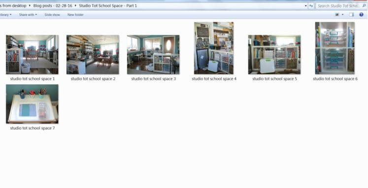 organizing digital photos in folder on laptop