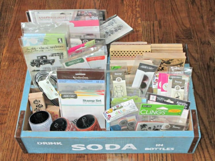 soda crate filled with rubber and acrylic stamps