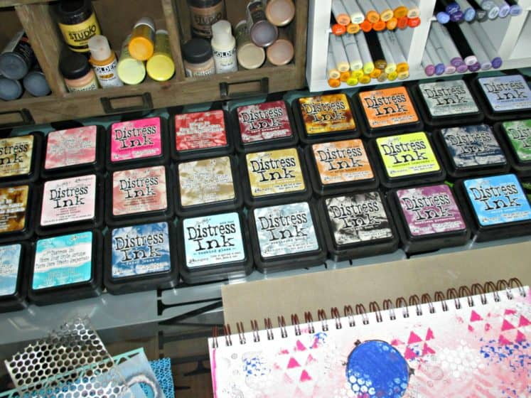 Distress Inks lined up on craft desk