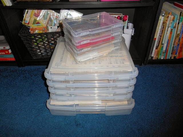 stack of clear Iris containers filled with organized ephemera