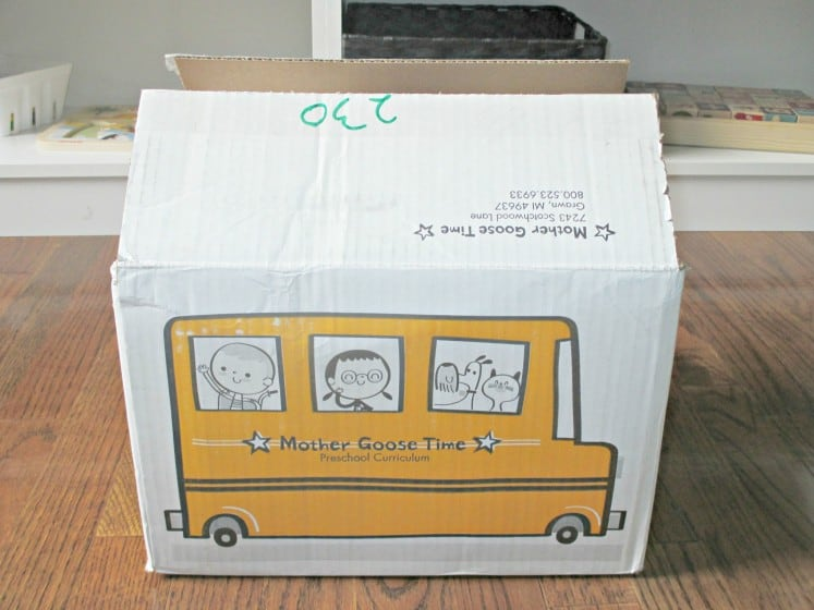 yellow cardboard school bus box full of Mother Goose Time preschool curriculum
