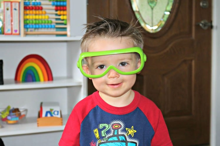 toddler boy wearing children's safety glasses