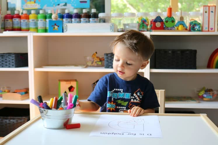 toddler boy coloring D is for Dolphin coloring page