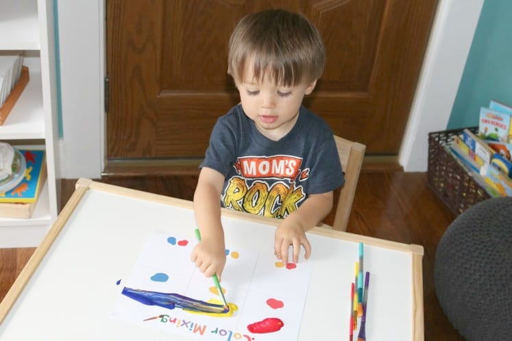 toddler painting on color mixing activity sheets
