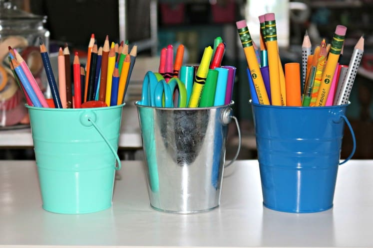 buckets filled with art supplies
