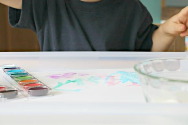 preschool exploring chemical reactions using watercolor paint and salt