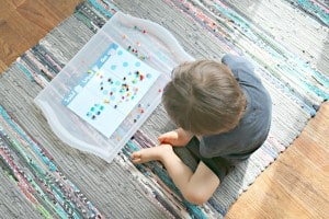 toddler exploring state of matter activity with beads