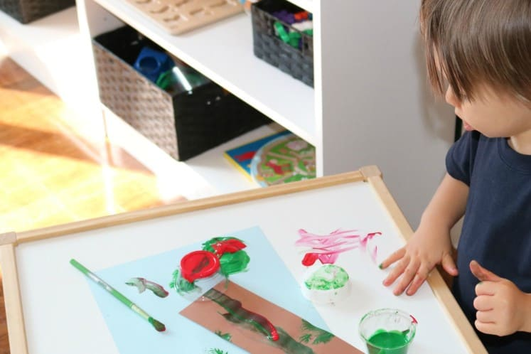 toddler creating family tree process art using paint and cardstock