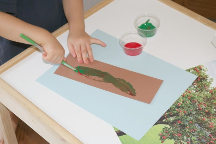 toddler painting on brown cardstock