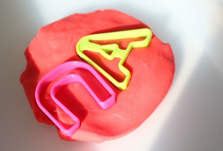 letter cookie cutters in play dough