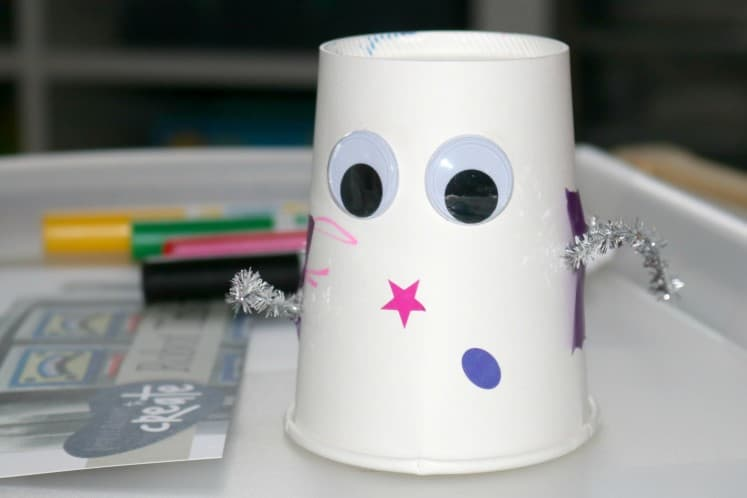 preschooler's robot art using paper cup, wiggle eyes and pipe cleaners