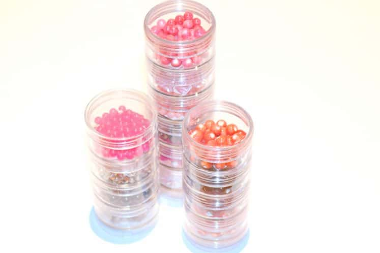 bright colored beads in clear stacking containers