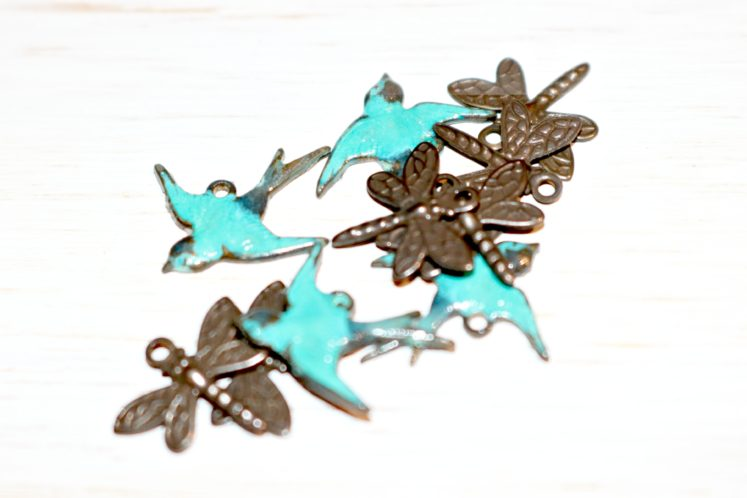 metal charms featuring dragonflies and birds