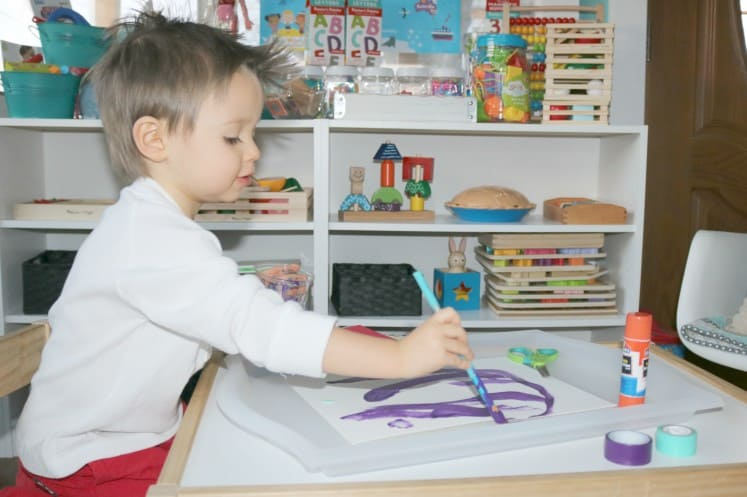 toddler painting on cardstock