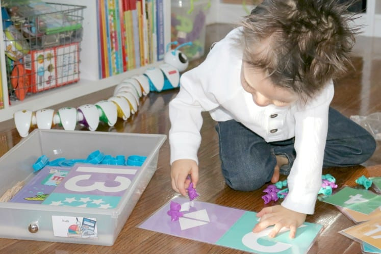 toddler counting manipulatives using number cards