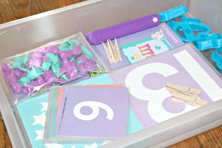 preschool math workbox filled with number cards, manipulatives and number cookie cutters