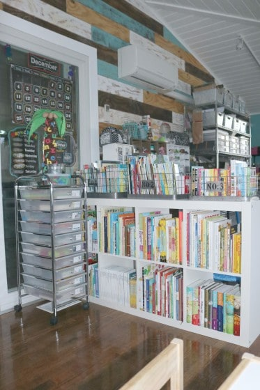 10-drawer rolling cart in front of cube shelf filled with children's books