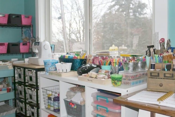 child's arts supplies on a shelf