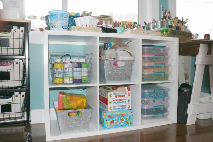 cube shelf filled with kids' art supplies