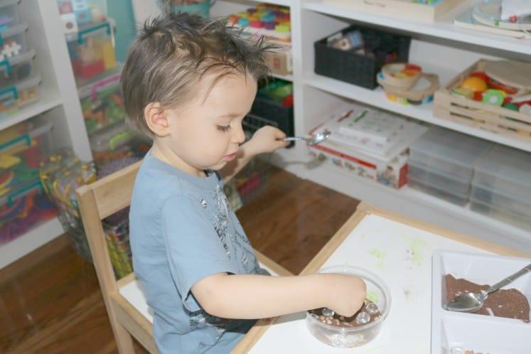 preschooler working on pond process art