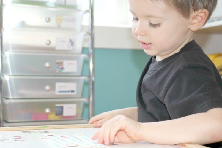 preschooler using craft stick puzzle to learn bible verse
