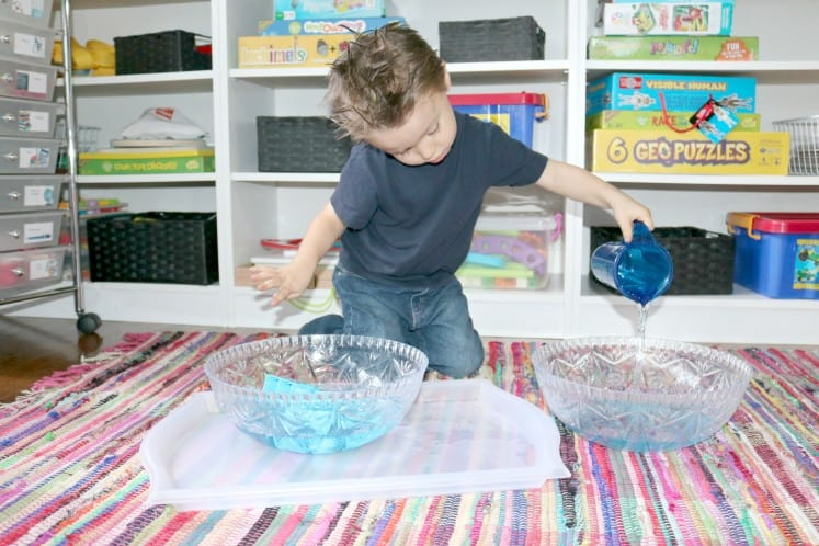preschooler pouring water in to another bowl