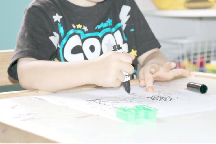 preschooler coloring with markers