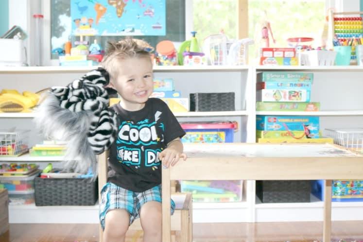 preschooler holding zebra puppet