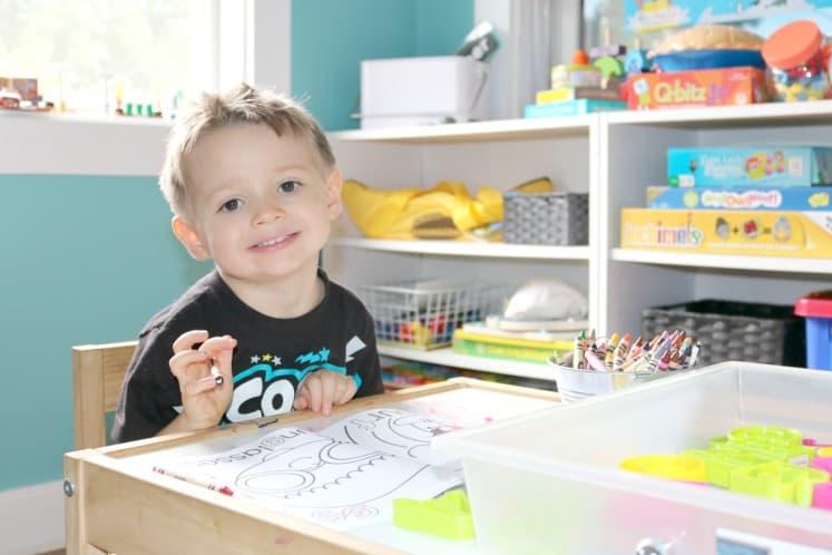 preschooler sitting at table coloring