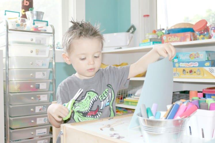 preschooler holding up a piece of cardstock