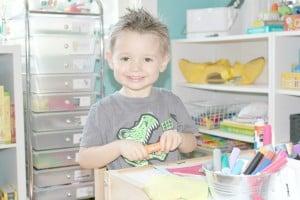preschooler opening paint stick