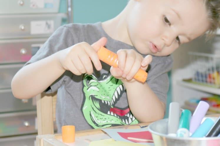preschooler twisting paint stick