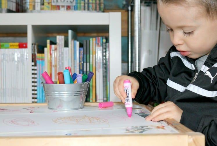 preschooler coloring with a marker