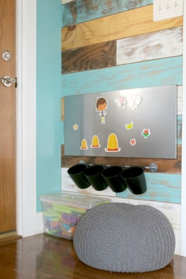 gray pouf in front of magnetic board with storytelling pieces