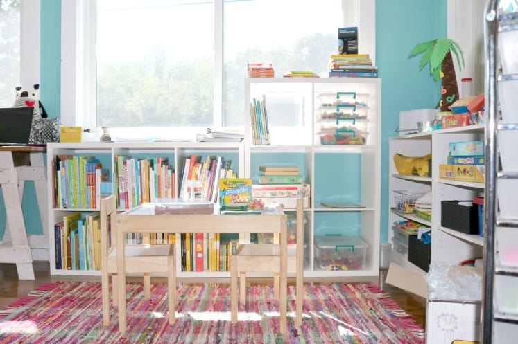 preschool space with cube bookshelves and table and chairs
