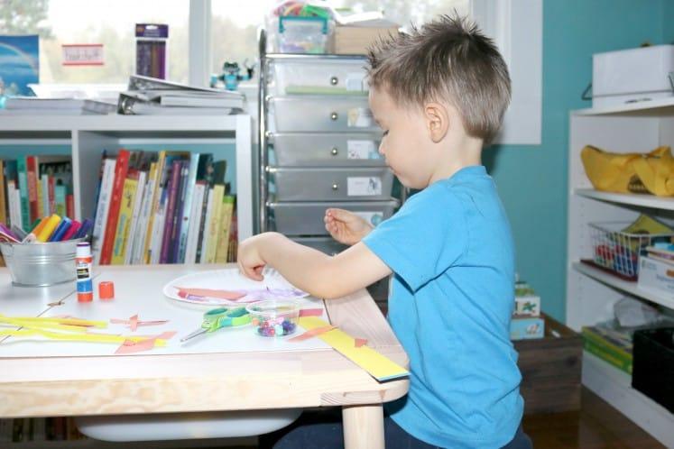 preschooler creating Rainbow Sculpture art